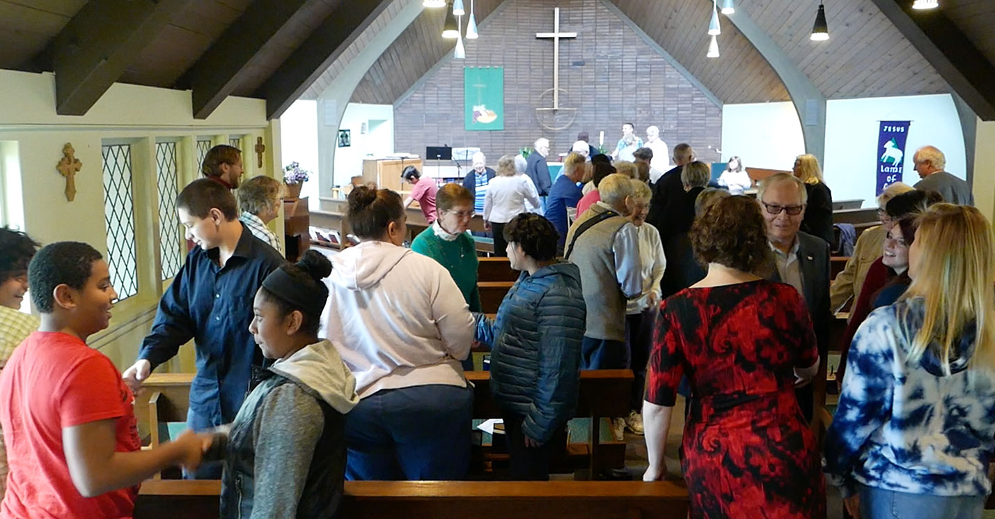 Sharing the peace at Faith Lutheran Church
